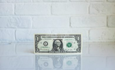 1 U.S. dollar banknote on white table
